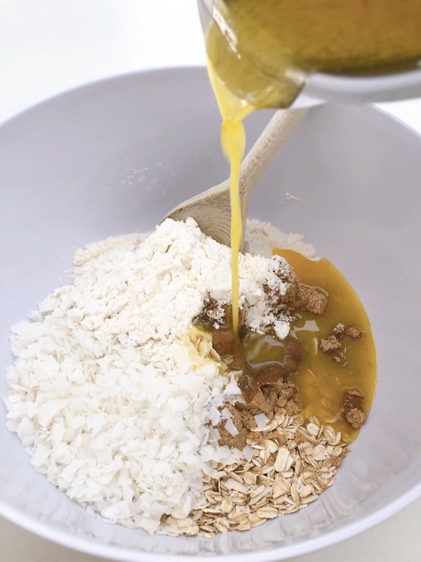 Mixing Anzac slice ingredients