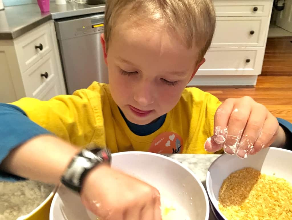 Kids cooking homemade cornflake chicken nuggets
