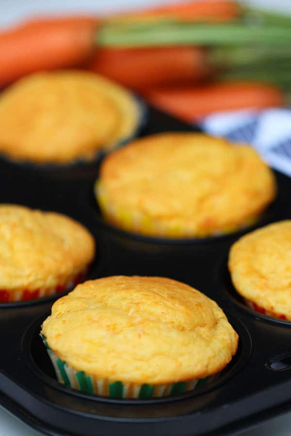 Cheese carrot muffins in baking tray.