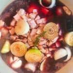 Coq au vin cooking in pot