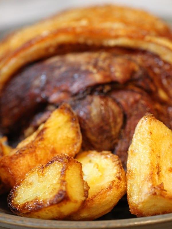 Roast pork dinner with roast potatoes