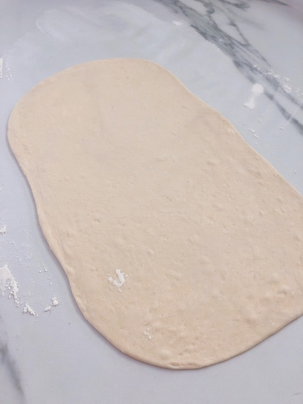 Rolling pizza dough for pizza scrolls