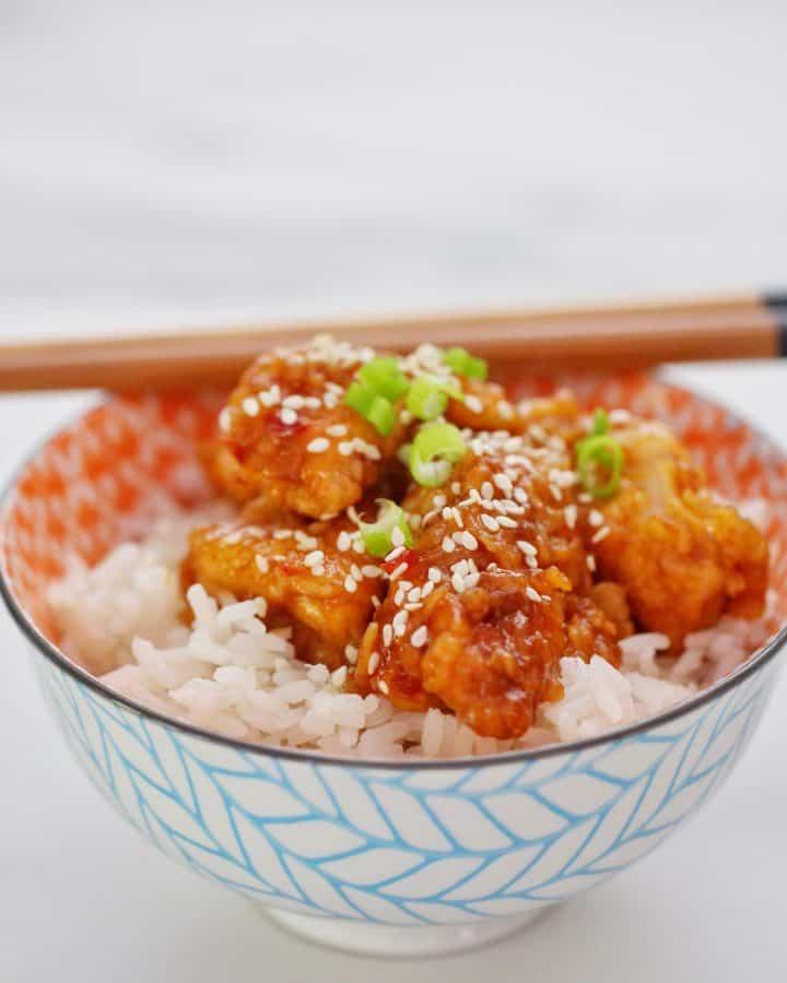 Sticky sesame chicken in bowl