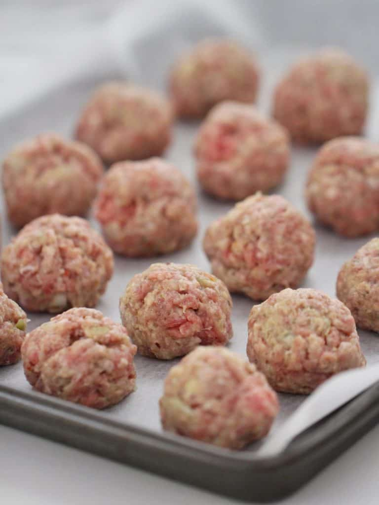 Italian meatballs on tray ready to be baked.