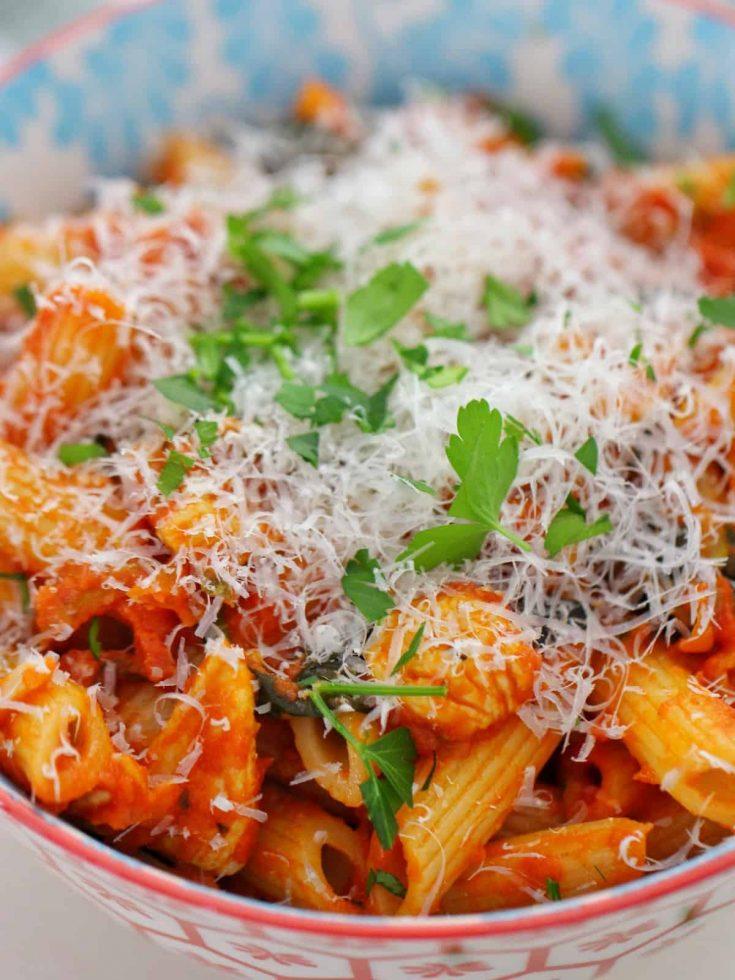 chicken creamy tomato pasta in bowl