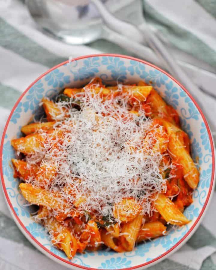 creamy chicken tomato pasta in bowl