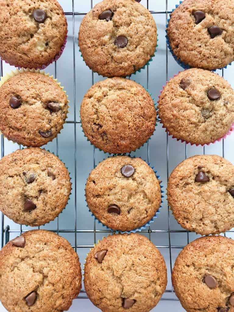 Choc chip banana muffins cooling on rack