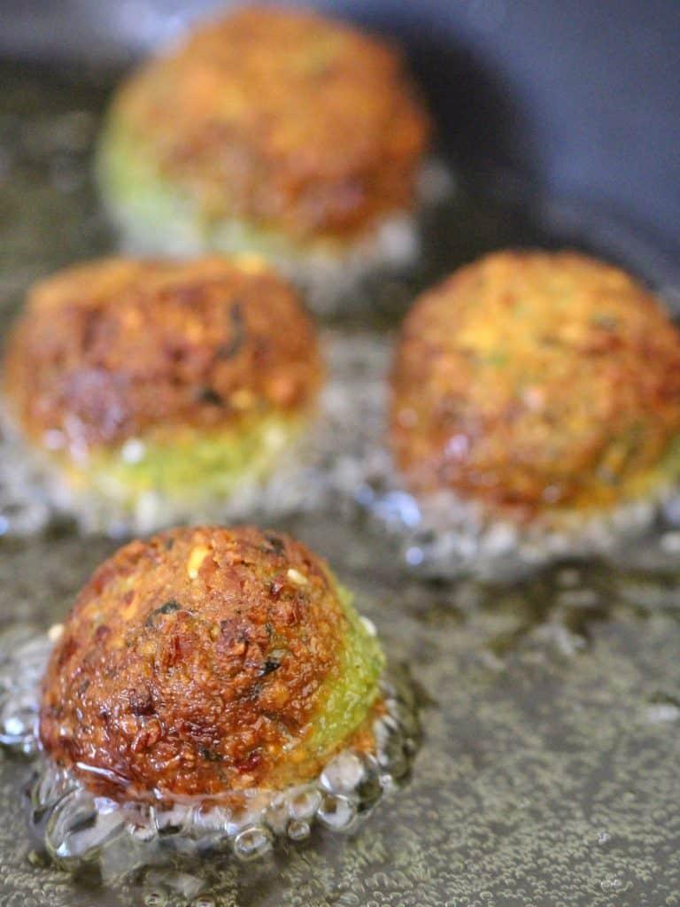 Frying falafel in oil