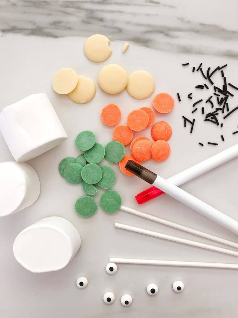 Ingredients and tools needed for Halloween Marshmallow pops