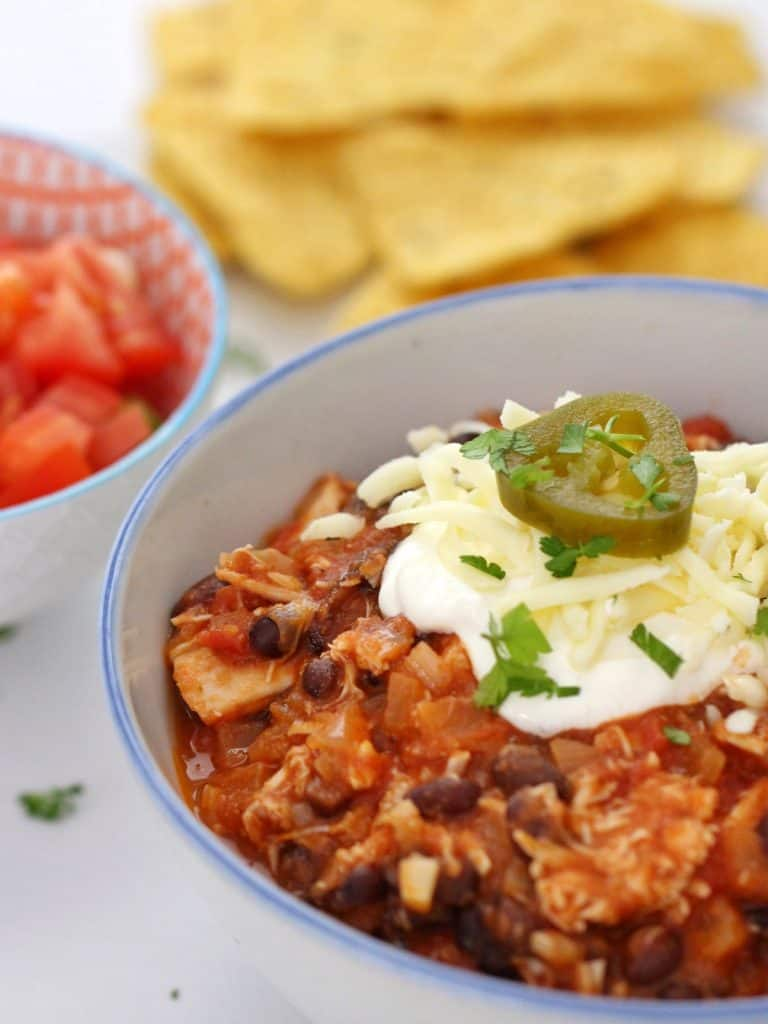 Leftover Turkey Chili in bowl with toppings