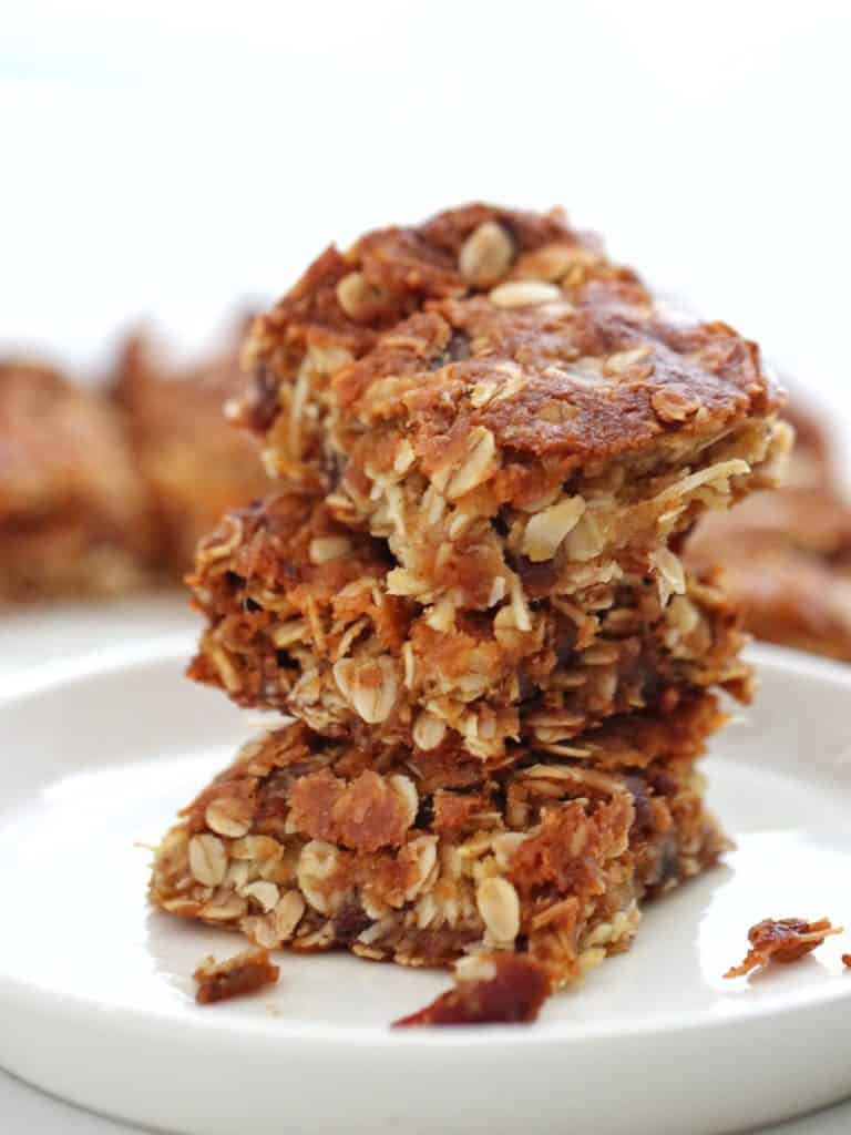 Oat and Date slice stacked on a plate