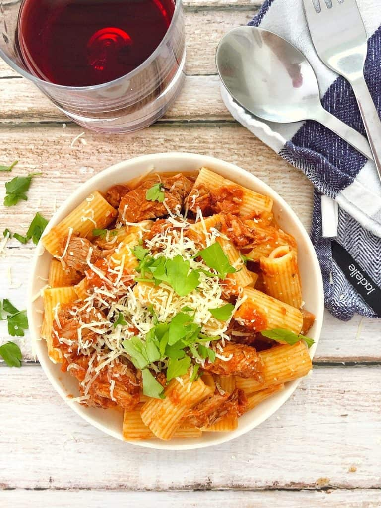 Slow cooked lamb ragu with pasta in a bowl