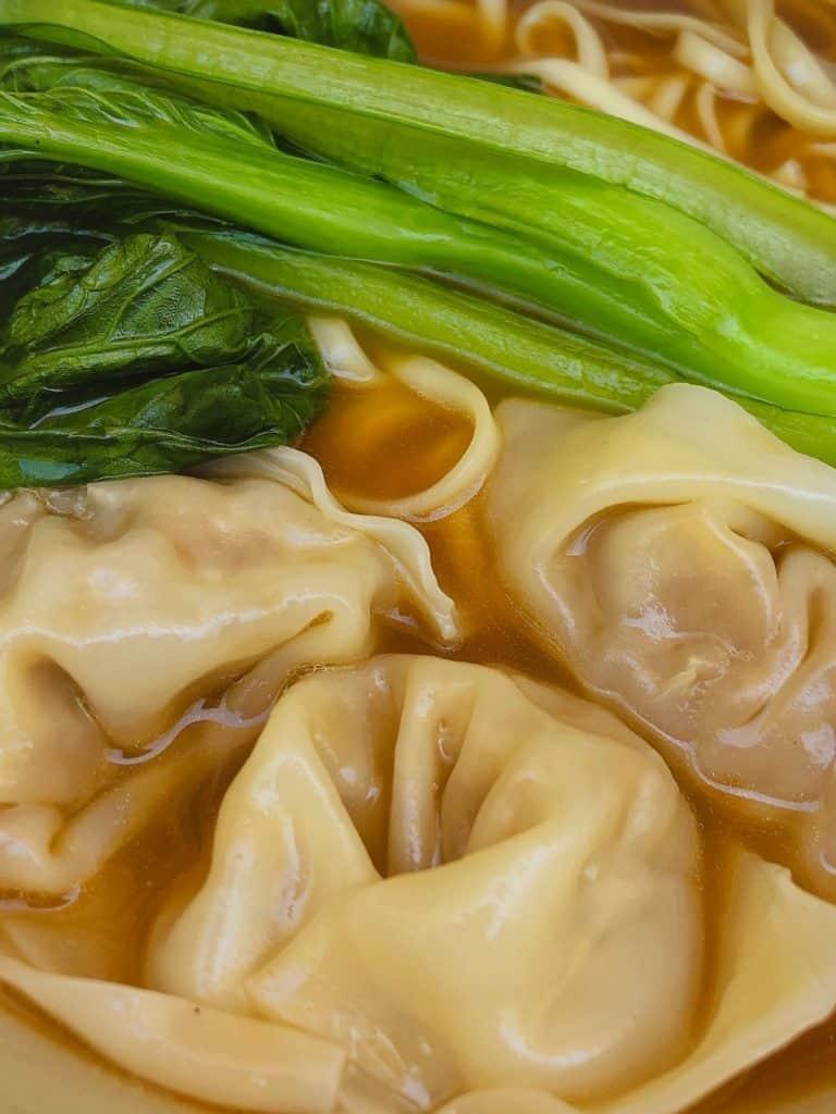 Close up of wonton noodle soup