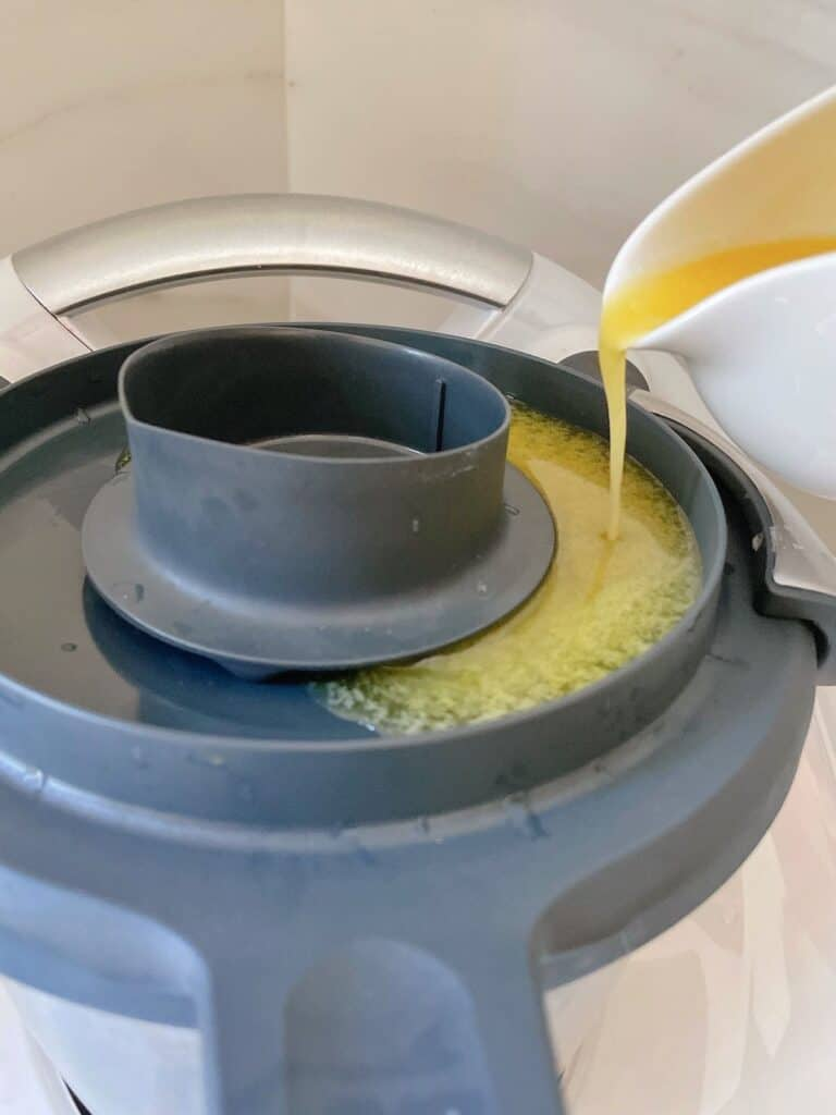 Pouring melted butter onto thermomix for Hollandaise sauce