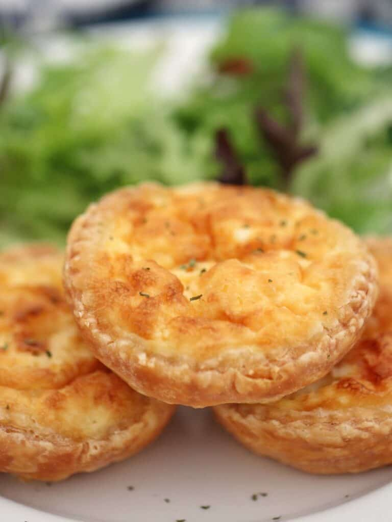 Mini quiches on a plate.