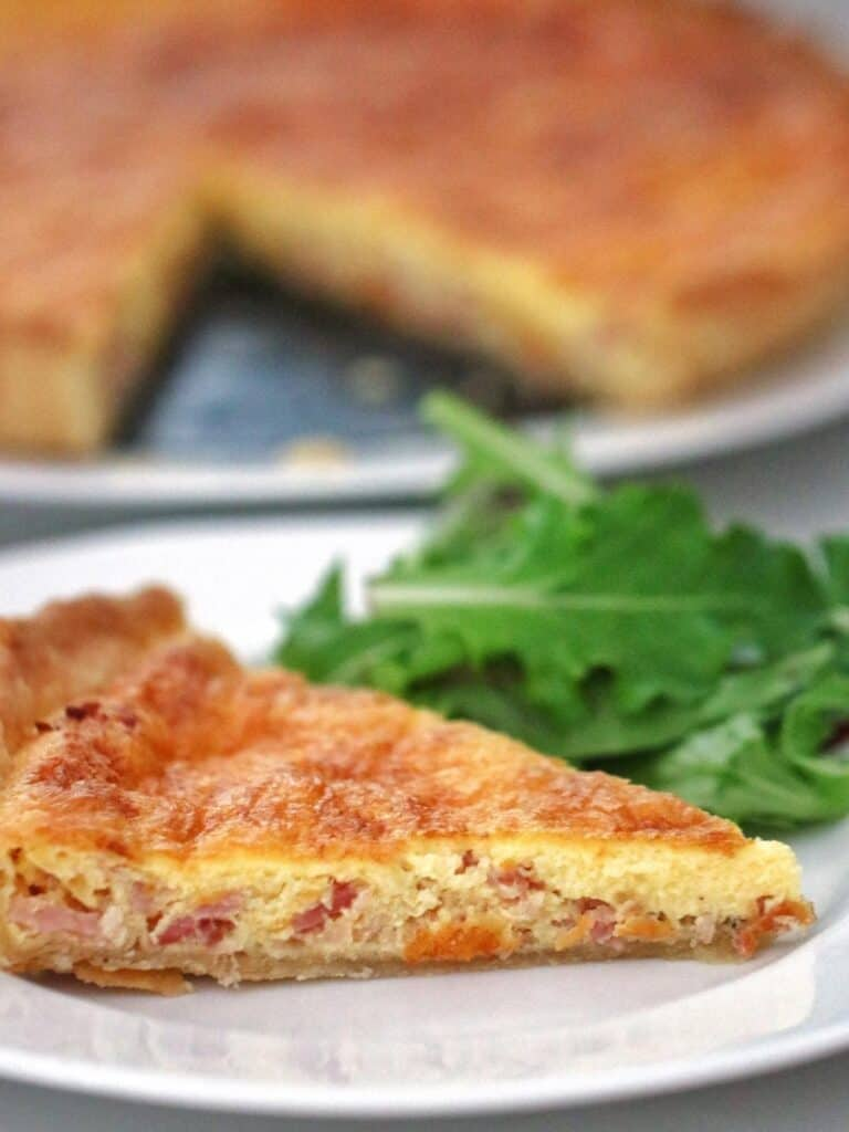 Slice of Thermomix Quiche Lorraine on a plate.