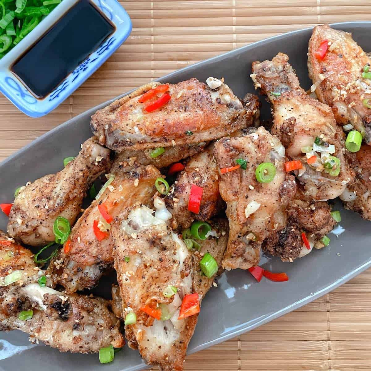 salt and pepper chicken wings on plate