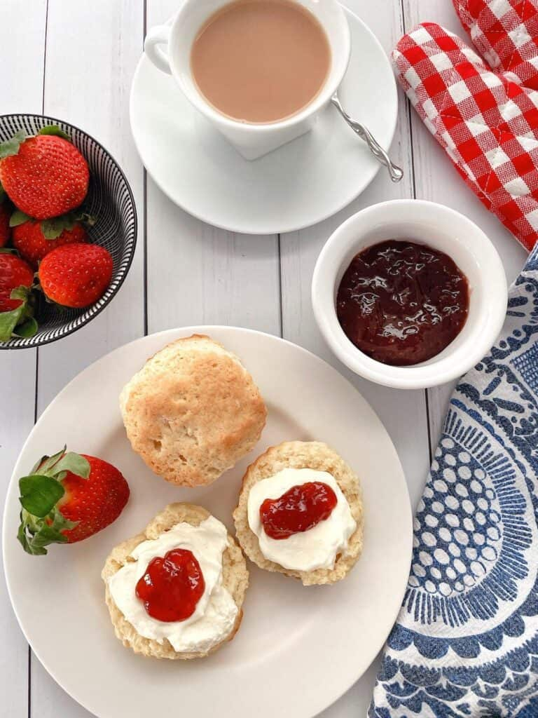 Thermomix scones with jam and cream on table for afternoon tea