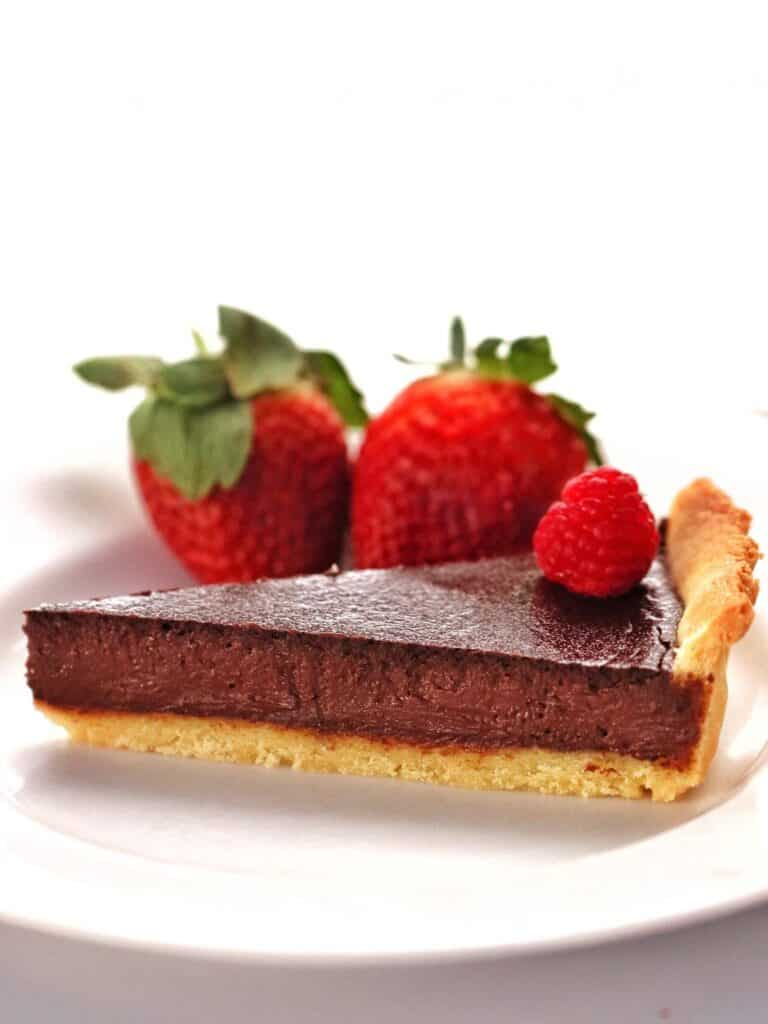 Slice of Thermomix Chocolate Tart with shortcrust pastry