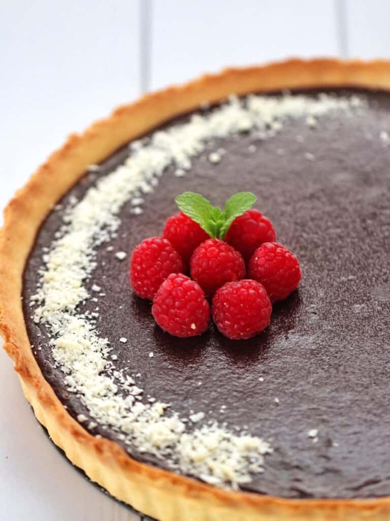 Thermomix Chocolate Tart close up with raspberries