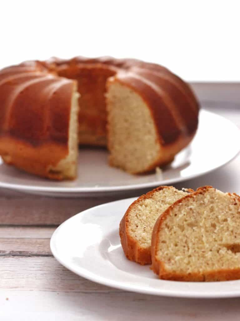 Thermomix Lemon Bundt Cake slices with cake in background