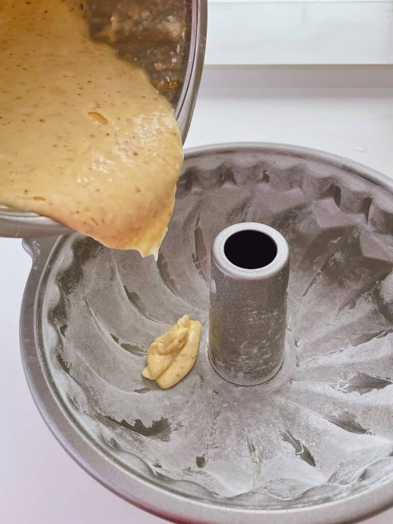 Pouring cake batter into bundt tin