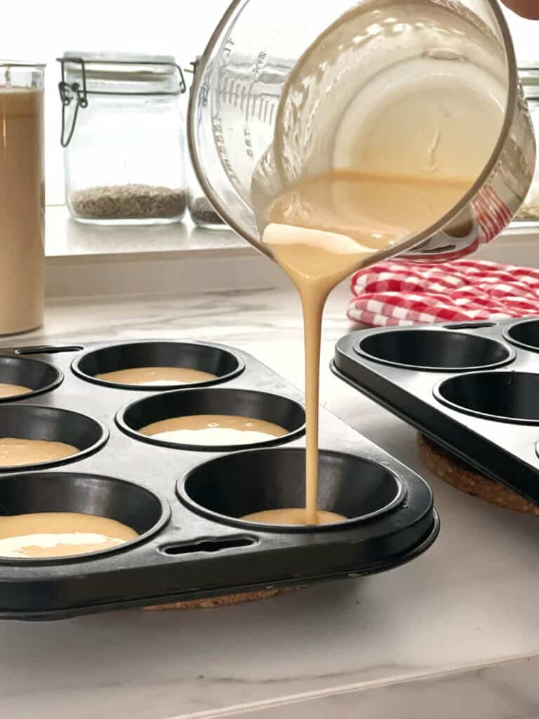 Pouring batter in tray for Thermomix Yorkshire Puddings