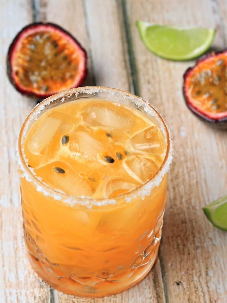 Passion fruit margarita on table