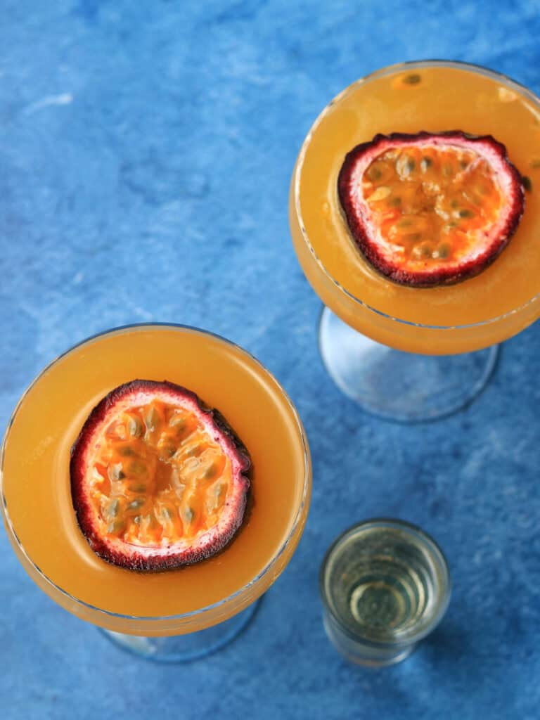 Pornstar Martinis from above with passion fruit floating in glass