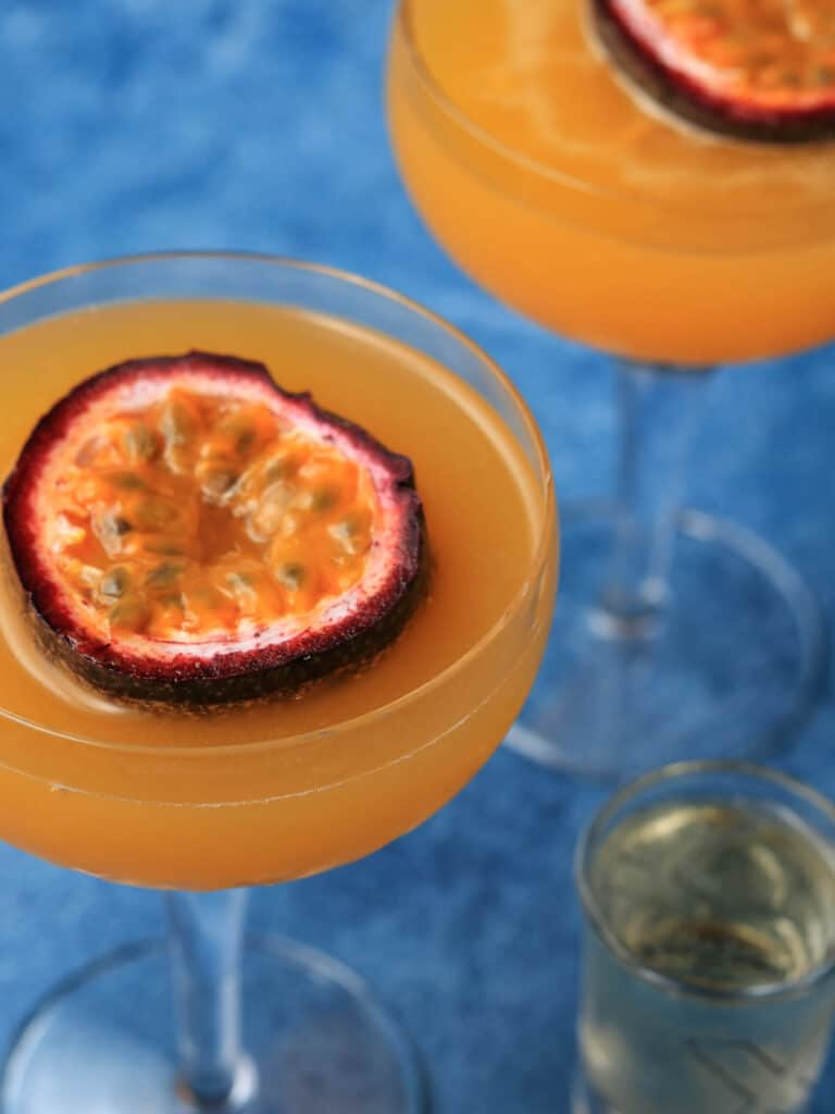 Close up of Passion fruit martini with champagne on side